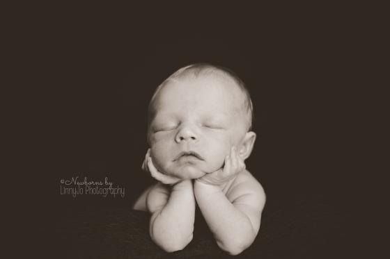 Black and white Newborn chin pose